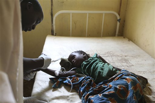 In this Monday, Sept. 6 file photo, a doctor treats a child suffering from cholera, at a village health clinic in Ganjuwa in Nigeria's rural Bauchi St...