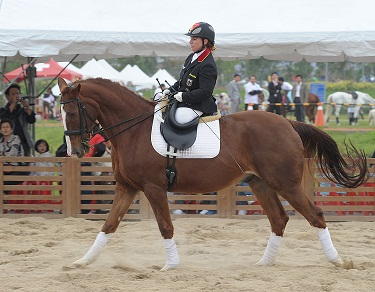 Angelika Trabert of Germany rides a horse in Taipei County yesterday.