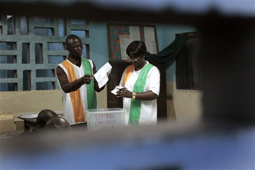 Election officials start counting ballots in the first round of presidential elections in Abidjan, Ivory Coast on Sunday. The West African nation of I...