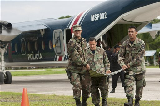 Costa Rican police officers unload supplies after their arrival at a provisional base in Barra del Colorado Sur near the border with Nicaragua on Oct....