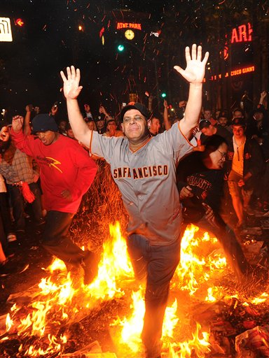 Giants fan Ron Galileo jumps through a bonfire outside AT&T Park on Monday in San Francisco after the Giants won the World Series.