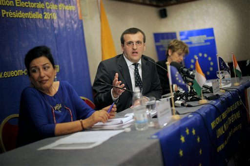 European Union Chief Elections Observer Christian Perda, center, from Romania, addresses a news conference in Abidjan, Ivory Coast on Tuesday. After f...