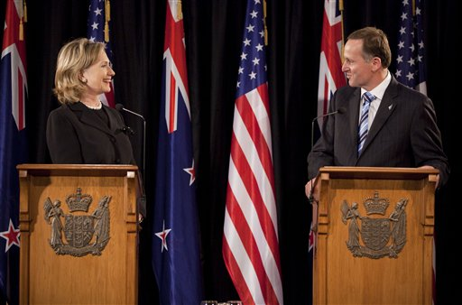 U.S. Secretary of State Hillary Rodham Clinton, left, looks at New Zealand Prime Minister John Key during a news conference at the Parliament Complex ...
