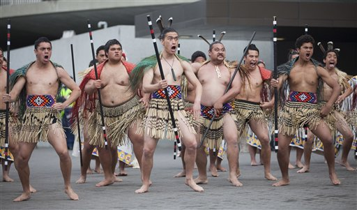 Dancers put on a traditional Maori welcoming ceremony for U.S. Secretary of State Hillary Rodham Clinton after arriving at the Parliament Complex toda...