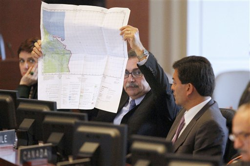 Costa Rica's Foreign Minister Rene Castro, holds up a map of Nicaragua while speaking to the Permanent Council of the Organization of American States ...