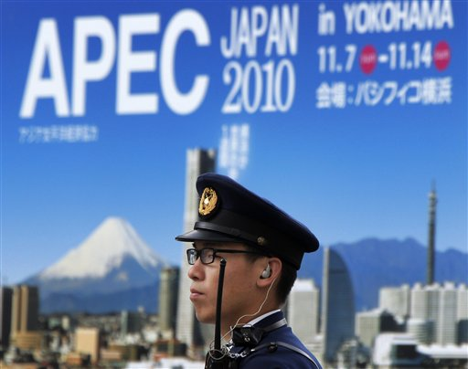 A Japanese police officer stands guard near the APEC venue in Yokohama near Tokyo, Japan on Tuesday. The Asia-Pacific Economic Cooperation forum holds...