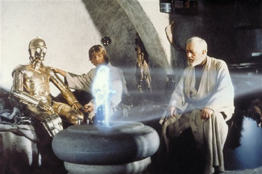In this publicity image released by LucasFilm Ltd & TM, characters, from left, Anthony Daniels portraying C-3PO, Mark Hamill portraying Luke Skywalker...