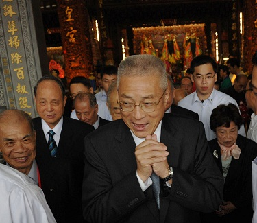 Premier Wu Den-yih gestures as he walked out of a temple in Taipei.