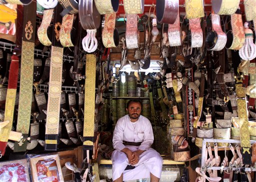 A Yemeni shopkeeper waits for customers at a market in the old San'a, Yemen on Tuesday.