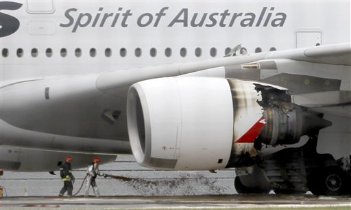 Firefighters surround a Qantas passenger plane which made an emergency landing with 459 people aboard in Singapore's Changi International Airport afte...