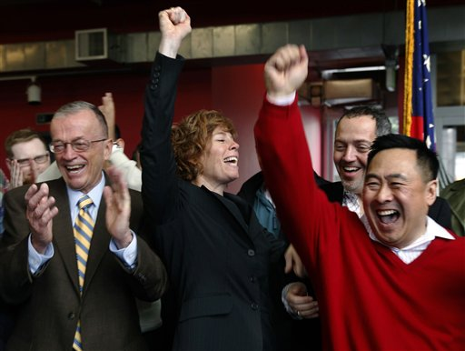 Retired Navy commander Zoe Dunning, center, celebrates the vote by the U.S. Senate at the LGBT Center in San Francisco, California on Saturday. The Se...