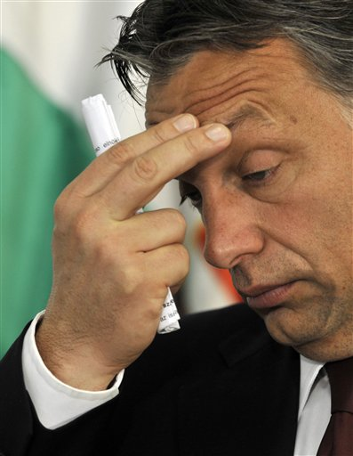 In this Oct. 12 photo, Hungarian Prime Minister Viktor Orban gestures during a press conference with President of the European Commission Jose Manuel ...