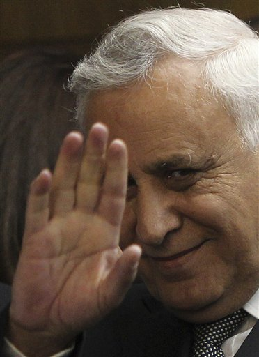 Former Israeli President Moshe Katsav gestures at a court in Tel Aviv, Israel yesterday. Katsav was convicted Thursday of raping an employee when he w...