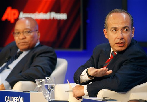 South Africa's President Jacob Zuma, left, and Mexico's President Felipe Calderon participate in a session on Climate Change at the World Economic For...