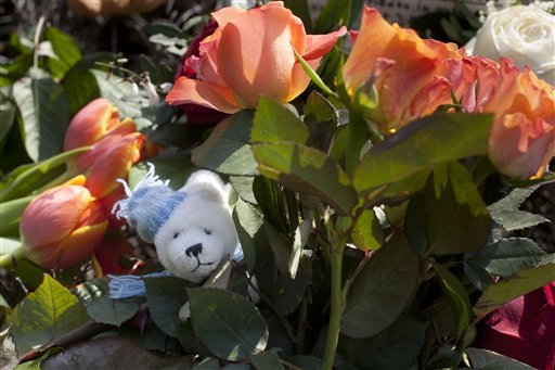 A toy Knut lays between flowers at the polar bear enclosure to commemorate late polar bear Knut at the Zoo in Berlin on Monday.