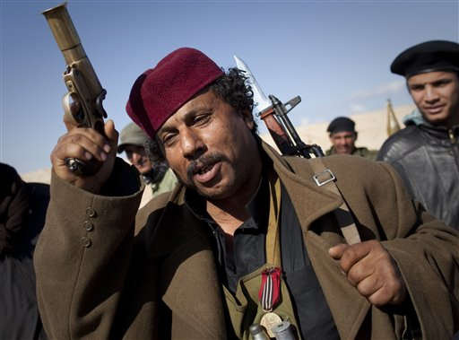 A Libyan rebel gestures before moving closer to the frontline after Moammar Gadhafi's forces fired on them on the frontline of the outskirts of the ci...