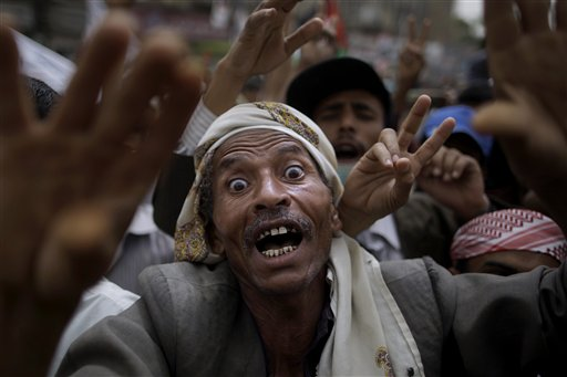 An anti-government protestor reacts during a demonstration demanding the resignation of Yemeni President Ali Abdullah Saleh, in Sanaa,Yemen yesterday.