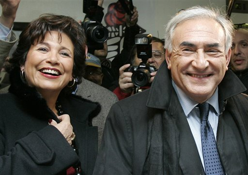 In this Nov.16, 2006 file photo, Dominique Strauss-Kahn with his wife Anne Sinclair, smile after voting in Sarcelles, outside Paris. Since their marri...