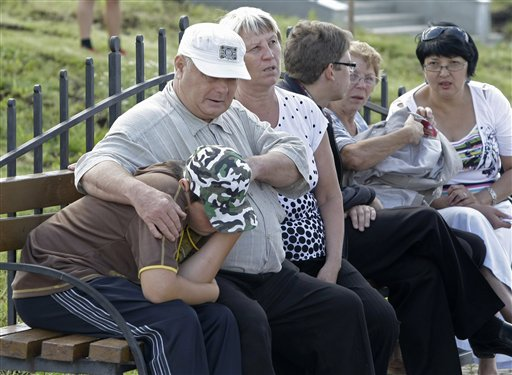 Relatives of survivors of a shipwreck react while waiting for a fresh information at a river Station in Kazan, about 450 miles (750 kilometers) east o...
