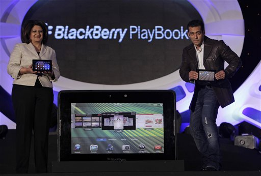 Bollywood actor Salman Khan, right and Research in Motion (RIM) India Managing Director Frenny Bawa unveil the BlackBerry PlayBook tablet in Mumbai, I...