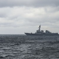 US Navy cruiser sails near Scarborough Shoal in South China Sea