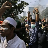6 dead in Indonesia riots, gov't restricts social media