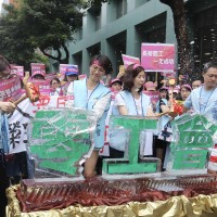 Taiwan EVA Air flight attendants protest ahead of strike vote results