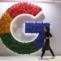 Google sign at an international import expo in Shanghai (AP)