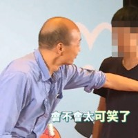 Han (left) pushing student (right). (Still from video)