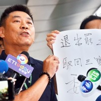 EVA Air official calling for return of IDs.