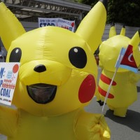 Filipino climate activists dressed as Pikachu protest against Japan's energy policy