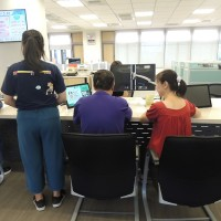 The 16-year-old girl (left) meets her biological father surnamed You (center) for the first time at Hsinchu City's Xiangshan Household Registration Office. (Xiangshan Household Registration Office photo)