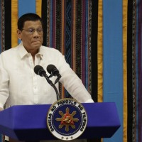 Duterte: Philippines can't stop China in disputed seas, won't risk clash
