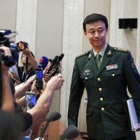 China warns against Taiwan independence, threatens military action