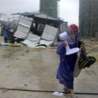 Chinese state TV: At least 13 dead after Typhoon Lekima hits Zhejiang Province, 16 missing