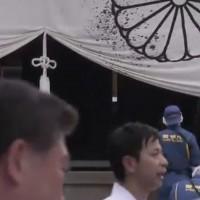 Chinese man spills black ink onto imperial emblem of Japan at Yasukuni Shrine