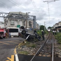 Train overturns car and kills driver in east Taiwan