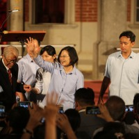 President Tsai Ing-wen (center) at Tainan concert with organizer Huang Kun-hu (left, in dark suit and red tie) Saturday September 14.