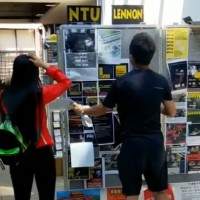 Video shows Chinese tourist rip down National Taiwan University Lennon Wall