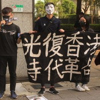 Hong Kong students and Taiwanese supporters protest outside trade office