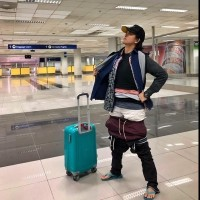 Photo of the Day: Filipina's solution to carry-on weight limit