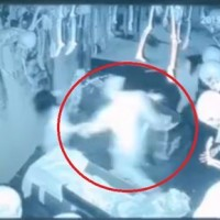 Girl grabs 'ghost' and runs out of haunted house in China