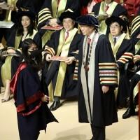 Hong Kong university president refuses handshakes with masked graduates