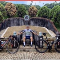 Ghoulish gaffe: Danish cyclist sits for pic on Taiwanese family tomb altar