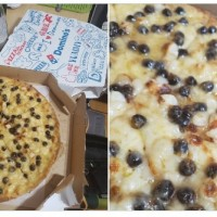 Photo of the Day: UC Irvine scholar tries Domino's Taiwan pearl milk tea pizza