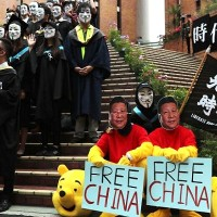 Masked university students rally at graduation ceremony in Hong Kong