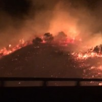 Video shows wildfire threaten freeway in W. Taiwan