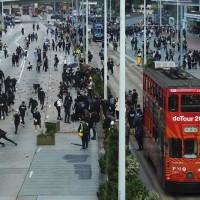 圖為11日香港街頭抗爭行動 (美聯社)