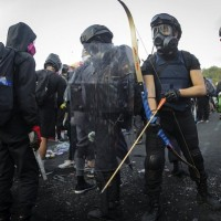 Officer shot with arrow as protesters make stand at Hong Kong university