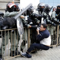 Riot police detain a protester in Hong Kong.